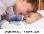 six year old toddler sharing... | Shutterstock . vector #550950526