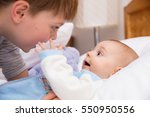 six year old toddler sharing... | Shutterstock . vector #550950556