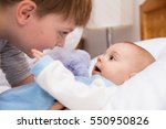 six year old toddler sharing... | Shutterstock . vector #550950826