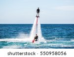 silhouette of a fly board rider ... | Shutterstock . vector #550958056