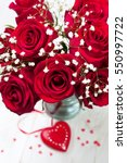 Stock photo festive bouquet of red roses and gypsophilas 550997722