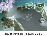 stethoscope on note book with... | Shutterstock . vector #551038816