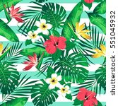 tropical flowers and leaves on... | Shutterstock . vector #551045932