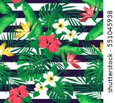 tropical flowers and leaves on... | Shutterstock . vector #551045938