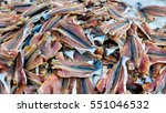 many dried fishes background... | Shutterstock . vector #551046532