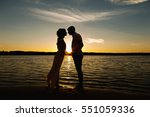 sea love  silhouette of young... | Shutterstock . vector #551059336