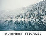 winter lake and snowy... | Shutterstock . vector #551070292