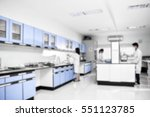 young laboratory assistant... | Shutterstock . vector #551123785