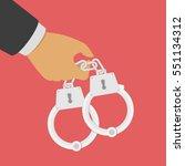 hand holding a handcuffs. a... | Shutterstock .eps vector #551134312
