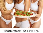 midsection of fit women posing... | Shutterstock . vector #551141776