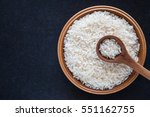 rice with wooden spoon in the... | Shutterstock . vector #551162755
