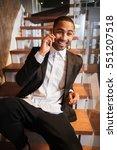 vertical image of happy african ...   Shutterstock . vector #551207518