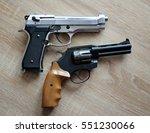 two pistols on wooden board. | Shutterstock . vector #551230066