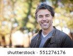handsome mature happy man... | Shutterstock . vector #551276176