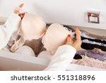 woman hands choosing lingerie....   Shutterstock . vector #551318896