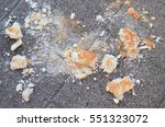 pieces of a bread on the street ...   Shutterstock . vector #551323072