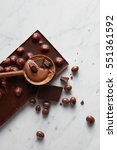 wooden spoon with chocolate | Shutterstock . vector #551361592
