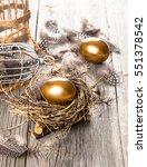 golden egg of chickens in nest  ... | Shutterstock . vector #551378542