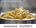 some steaming boiled pasta in a ... | Shutterstock . vector #551390872