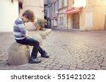 upset problem child sitting on... | Shutterstock . vector #551421022