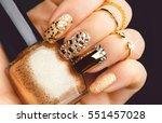 golden nail art manicure.... | Shutterstock . vector #551457028