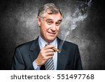 Confident senior businessman smoking a cigar