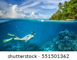 Woman Swims Around A Coral Ree...