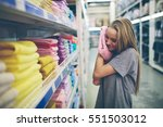 beautiful woman inspecting and... | Shutterstock . vector #551503012