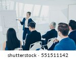 group of employees discussing... | Shutterstock . vector #551511142