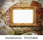 old brick wall with golden frame - stock photo