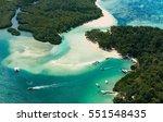 Aerial picture of Mauritius Island. Boat sailing around l