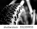 Bicycle wheel and tire close up on tread abstract - stock photo