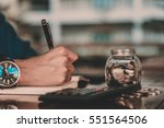 close up of people hand work... | Shutterstock . vector #551564506