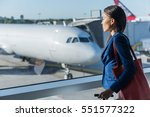 woman looking at window in... | Shutterstock . vector #551577322