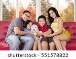 Image Of Joyful Family Holding...