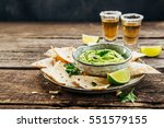 nachos on plate and avocado... | Shutterstock . vector #551579155