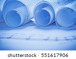 rolled blueprint very close up... | Shutterstock . vector #551617906