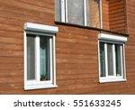 windows with rolling shutter... | Shutterstock . vector #551633245