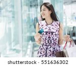 asian woman using credit card... | Shutterstock . vector #551636302