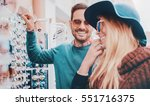 handsome young couple buying... | Shutterstock . vector #551716375