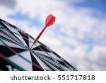 red dart arrow hitting in the... | Shutterstock . vector #551717818