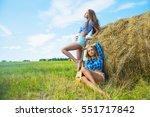 Two Hippie Girls Standing Near...