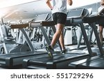 sportsman using jogging track... | Shutterstock . vector #551729296
