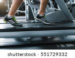 sporty guy at jogging track | Shutterstock . vector #551729332