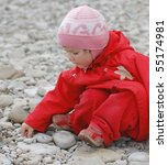 Portrait Of Baby On Pebble...
