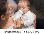 adorable baby with a milk... | Shutterstock . vector #551776492