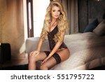 sexy blonde woman in black... | Shutterstock . vector #551795722