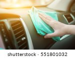 hand with microfiber cloth... | Shutterstock . vector #551801032