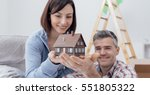 happy smiling couple holding a... | Shutterstock . vector #551805322