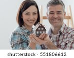 happy couple holding their... | Shutterstock . vector #551806612